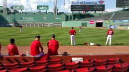 Watching pitching practice before the game